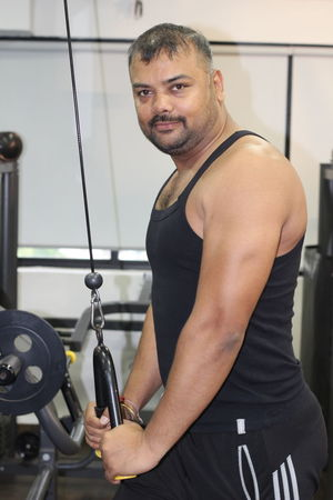Athlete Dumbbell Exercise Bike Exercise Equipment Exercising Gym Health Club Healthy Lifestyle Indoors  Leisure Activity Lifestyles Men Muscular Build One Person Portrait Real People Self Improvement Sport Sports Clothing Sports Training Sportsman Standing Strength Strength Training Young Adult