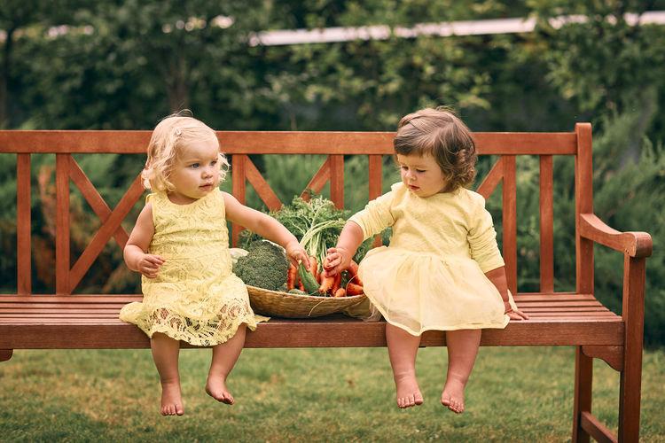 Cute girls sitting outdoors