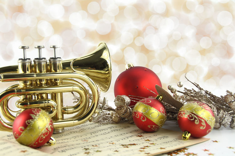 Close-up of trumpet and christmas decorations against defocused background