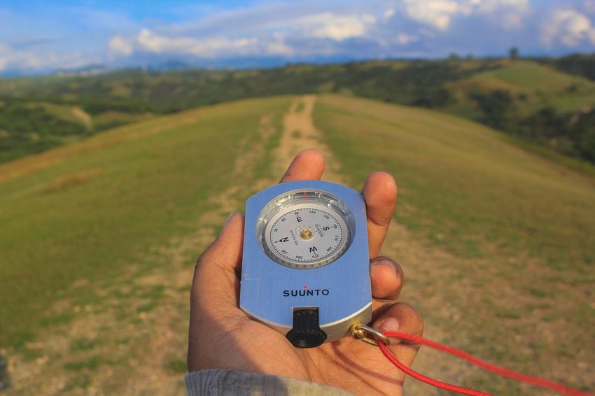 Compas & nature Suunto Compass Hand Survey Human Hand Field Holding Real People Men One Person Sky Landscape Outdoors Human Body Part Day Measuring Nature Lifestyles Instrument Of Measurement Human Finger Personal Perspective Time