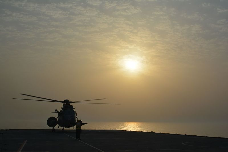 Helicopter against sunset