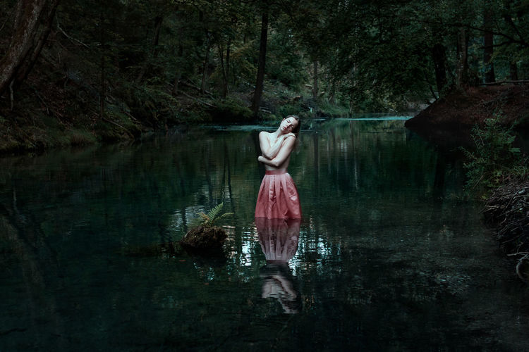 Fine Art Portrait of a woman standing in water Creativity Fine Art Photography The Week on EyeEm TheWeekOnEyeEM Art Atmospheric Mood Blonde Hair Canon Canon EOS 750D Canonphotography Forest Lake Mystical Atmosphere Nature One Person Reflection Reflections In The Water Sensual_woman Sigma 30mm/1.4 Art Skirt Tranquility Tree Water Women