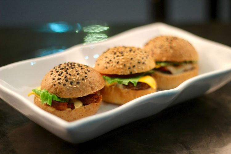Hamburgers in plate on table