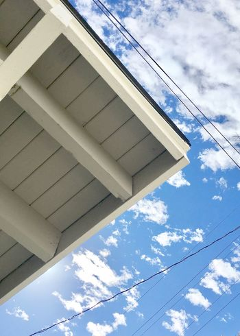 Angles And Lines Looking Up Triangles Low Angle View Cloud Sky Architecture Built Structure Power Line  Cable Building Exterior Day Cloud - Sky Office Building Outdoors Modern Blue High Section Tall Cloudy Steel Cable City Life No People Wires