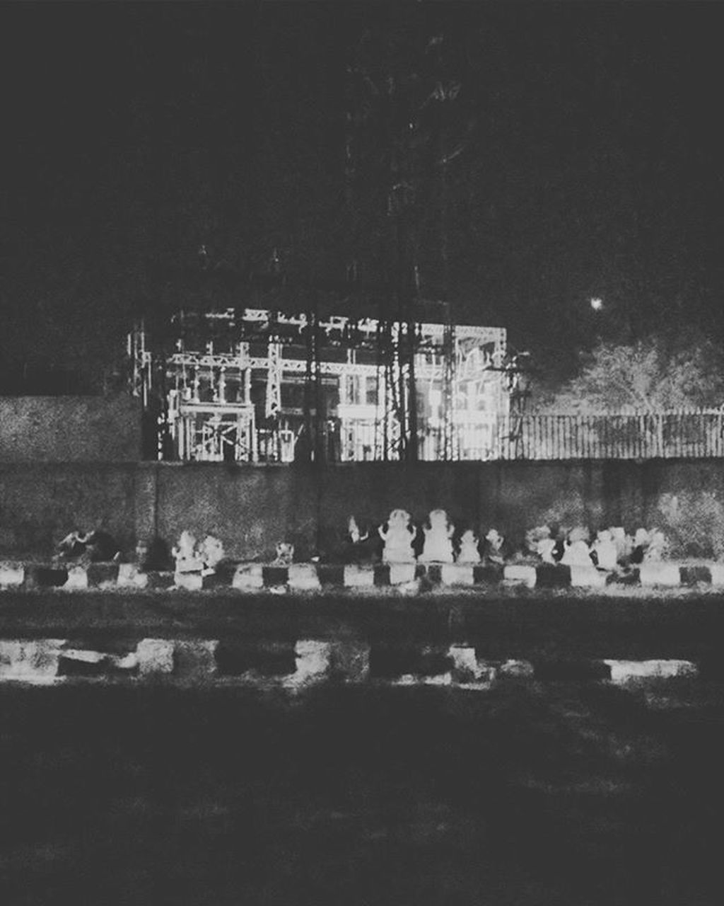 built structure, night, architecture, building exterior, large group of people, outdoors, real people, tree, water, men, sky, nature, people