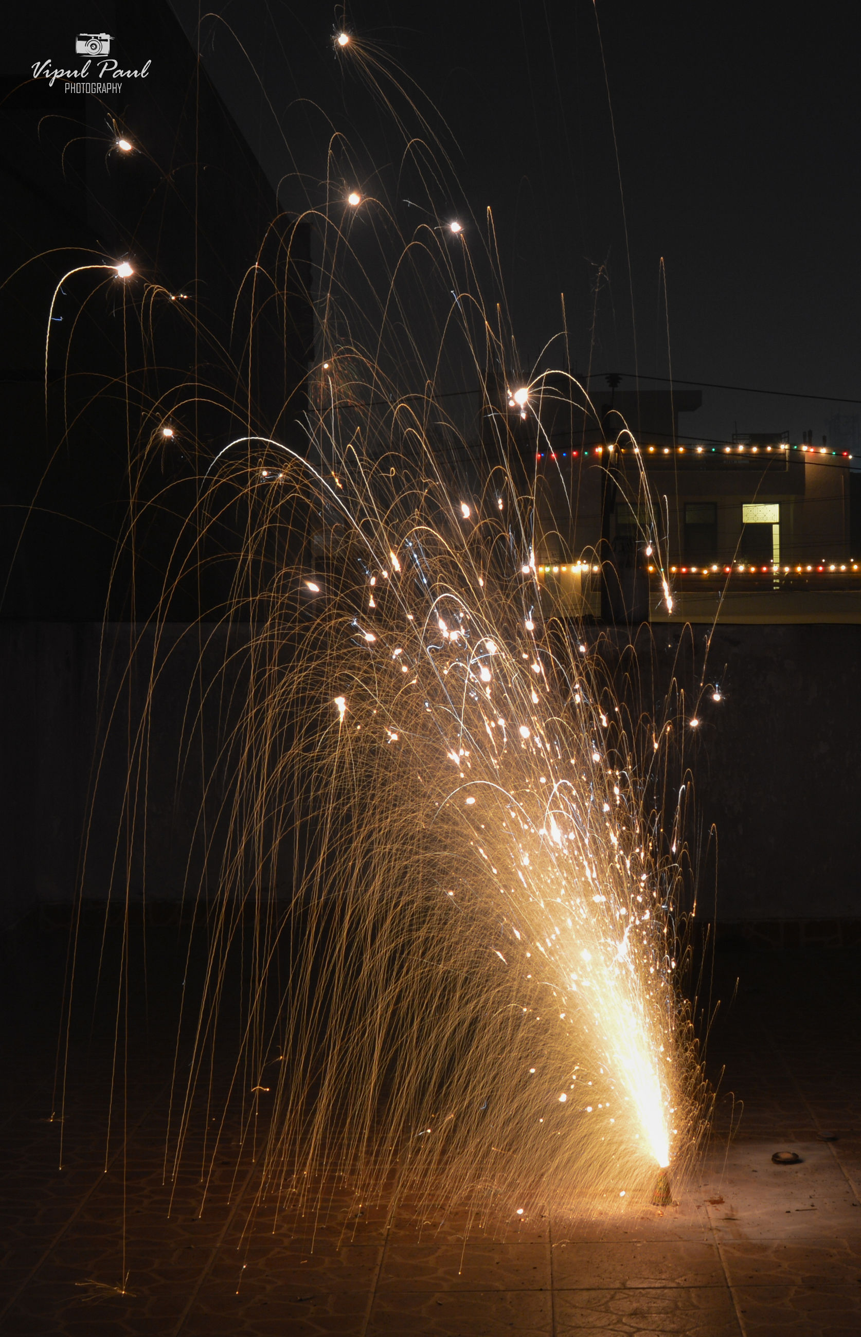 night, illuminated, long exposure, motion, glowing, light trail, sparks, lighting equipment, blurred motion, firework display, exploding, celebration, arts culture and entertainment, sky, firework - man made object, light - natural phenomenon, speed, street light, dark, outdoors