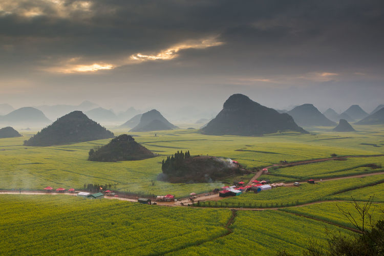 Scenics - Nature Sky Landscape Beauty In Nature Mountain Cloud - Sky Environment Field Plant Tranquil Scene Land Nature Tranquility Green Color Non-urban Scene Grass Agriculture Rural Scene Sunset Growth Mountain Range No People Outdoors