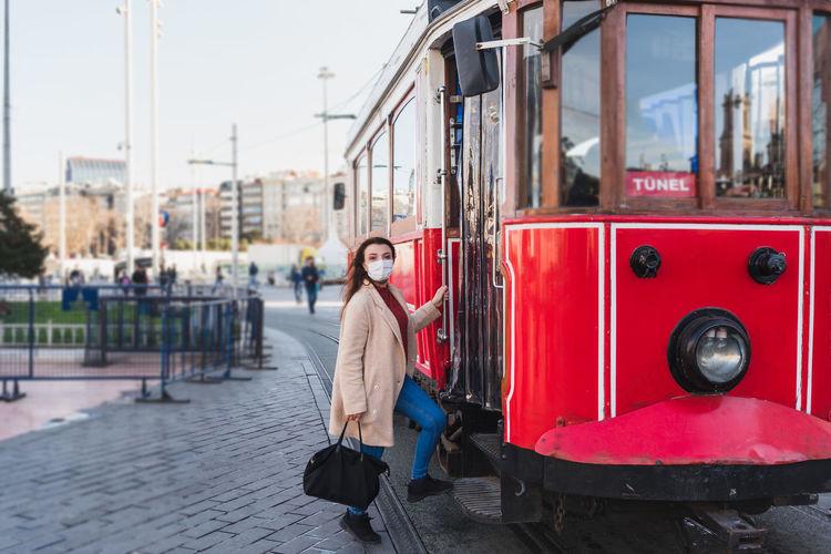 Portrait of woman boarding train