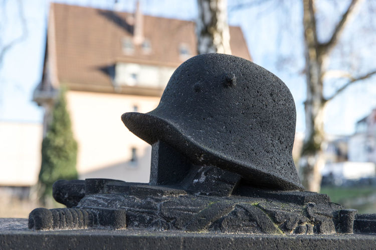Close-up of statue against stone wall