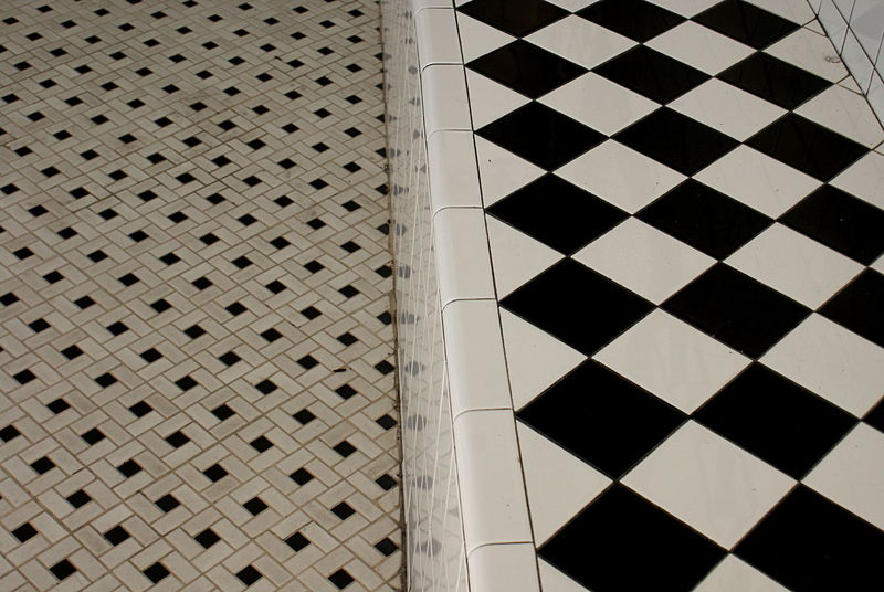 Retro geometric pattern ceramic tile floor and bench. Architecture Black And White Building Exterior Built Structure City Day Floor Geometric Shapes Graphic Linear Modern No People Outdoors Pattern Repetition Retro Sidewalk Squares And Lines Tiles Vintage Minimalist Architecture