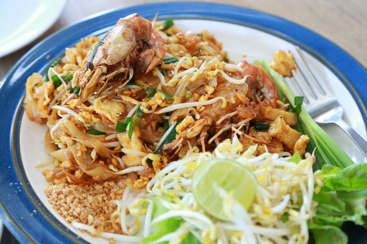 Close-up of pad thai kung  served on plate