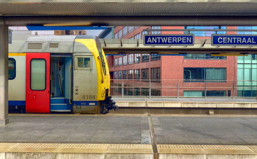 Antwerp, Belgium - Anno 2019: The train is waiting at the platform for passengers Inside the beautiful, historic and monumental Antwerp Train Station. Antwerp Central is often considered to be one of the most beautiful railway stations in the world. Transportation Rail Transportation Public Transportation Mode Of Transportation Architecture Railroad Station Platform Built Structure Railroad Station Train No People Train - Vehicle Travel Communication Yellow Sign Text Glass - Material Outdoors Day Track Station Platform