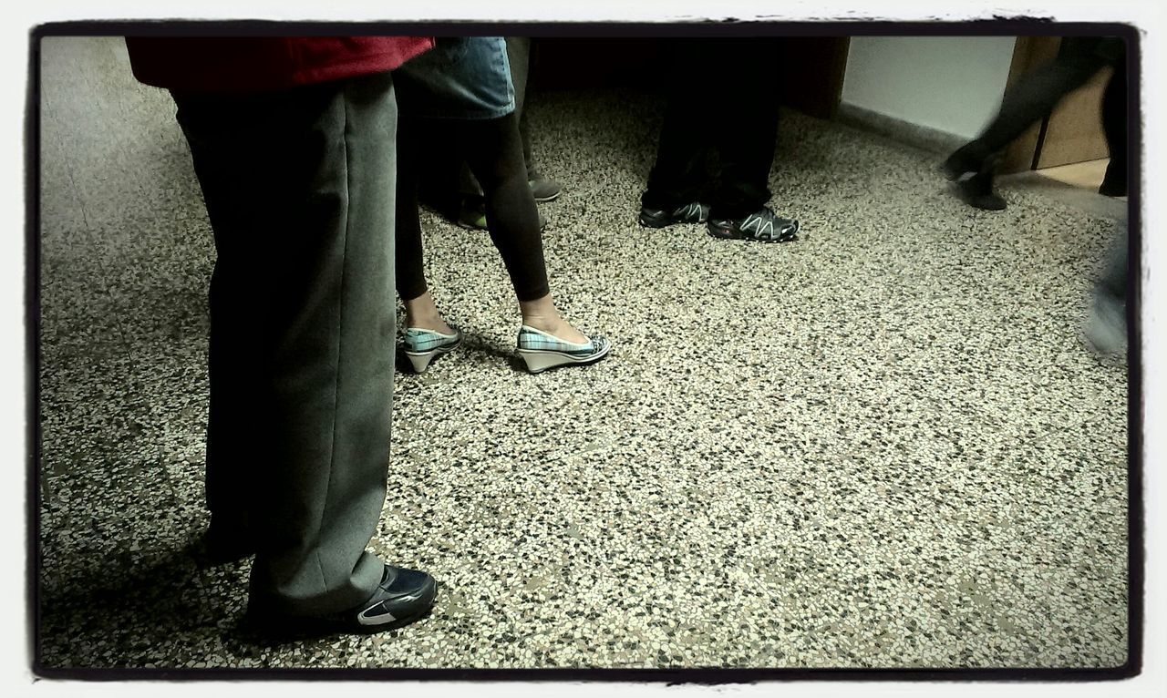 low section, human leg, standing, men, real people, shoe, two people, togetherness, day, lifestyles, women, indoors, adult, people
