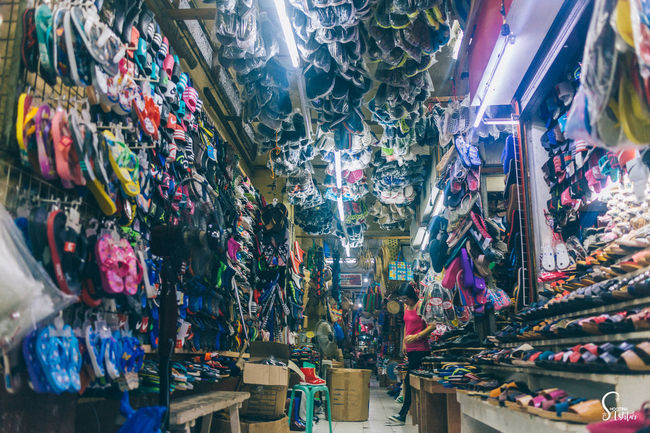 Slippers for sale Business Business Stories Economics Market Slippers Small Business Abundance Business Finance And Industry Choice Footwear Footwears For Sale Hanging Indoors  Large Group Of Objects Market Stall Multi Colored Retail  Seller Selling Shoes Variation
