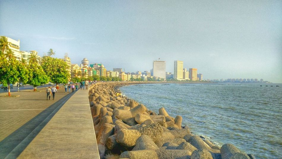 The Great Outdoor With Adobe Architecture Nature City Life Day Outdoors Arabian Sea Lifestyles Churchgate Marine Drive,mumbai Historical Monuments Mumbai Rock - Object Built Structure Sunlight Vacations Cityscape Marine Drive Water Sky The Way Forward Tourism