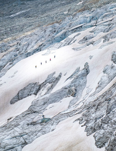 High angle view of people on rocky mountain