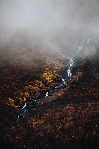 View of waterfall during autumn on a foogy day