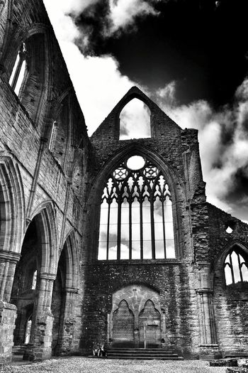 Architecture Arch Built Structure Low Angle View Window Shadows & Lights Photography Blackandwhite Black & White Blackandwhite Photography Black&white Abbey Ruins Abbey Tintern Abbey Clouds Dramatic Sky