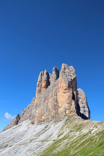 rock formation in the Dolomites Sky Dolomites Dolomites, Italy Italy❤️ Rock Rock - Object Rock Formation Mountain Nature Low Angle View Blue Beauty In Nature Clear Sky Scenics - Nature Day Tranquil Scene Sunlight Tranquility No People Copy Space Non-urban Scene Formation Outdoors Mountain Peak Mountain Range