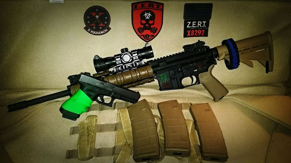 Couple of my baby's. Glock 22 .40 Cal Spikestactical Ar15 5.56 Zert X8292