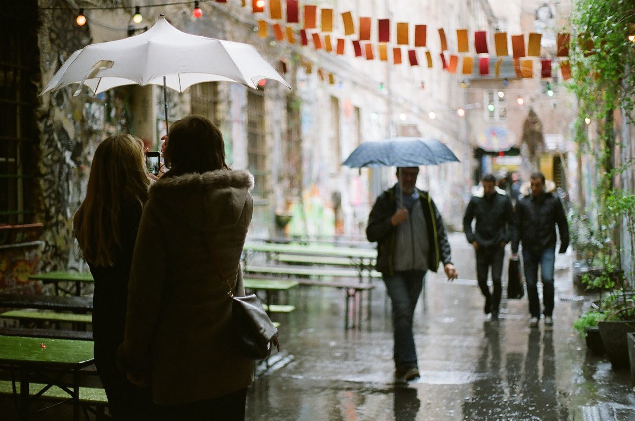 rain, wet, water, protection, real people, women, friendship, men, outdoors, under, day, adult, people, adults only