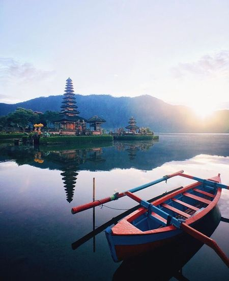 📍Pura Ulan Danu Bratan, Bedugul Water Lake Nautical Vessel Mountain Reflection Transportation Tranquil Scene Tranquility Boat Scenics Moored Mode Of Transport Sun Standing Water Beauty In Nature Sky Nature Harbor Majestic Bedugul Traveling Travel Waterfront