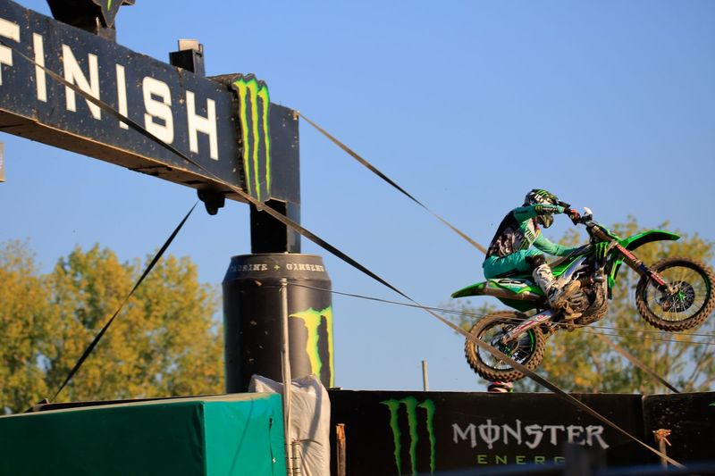 Beyond the finish Helmet Monster Energy Moment Best EyeEm Shot Remember EventPhotography Race Pilot Finish Line  EyeEm Best Shots Tamron150600mm Canon5Dmk3 Canonphotography Kawasaki Motocross MXGP Motocross Motor Vehicle Velocity Sky Low Angle View Communication Text Nature Clear Sky Sign Hanging Day