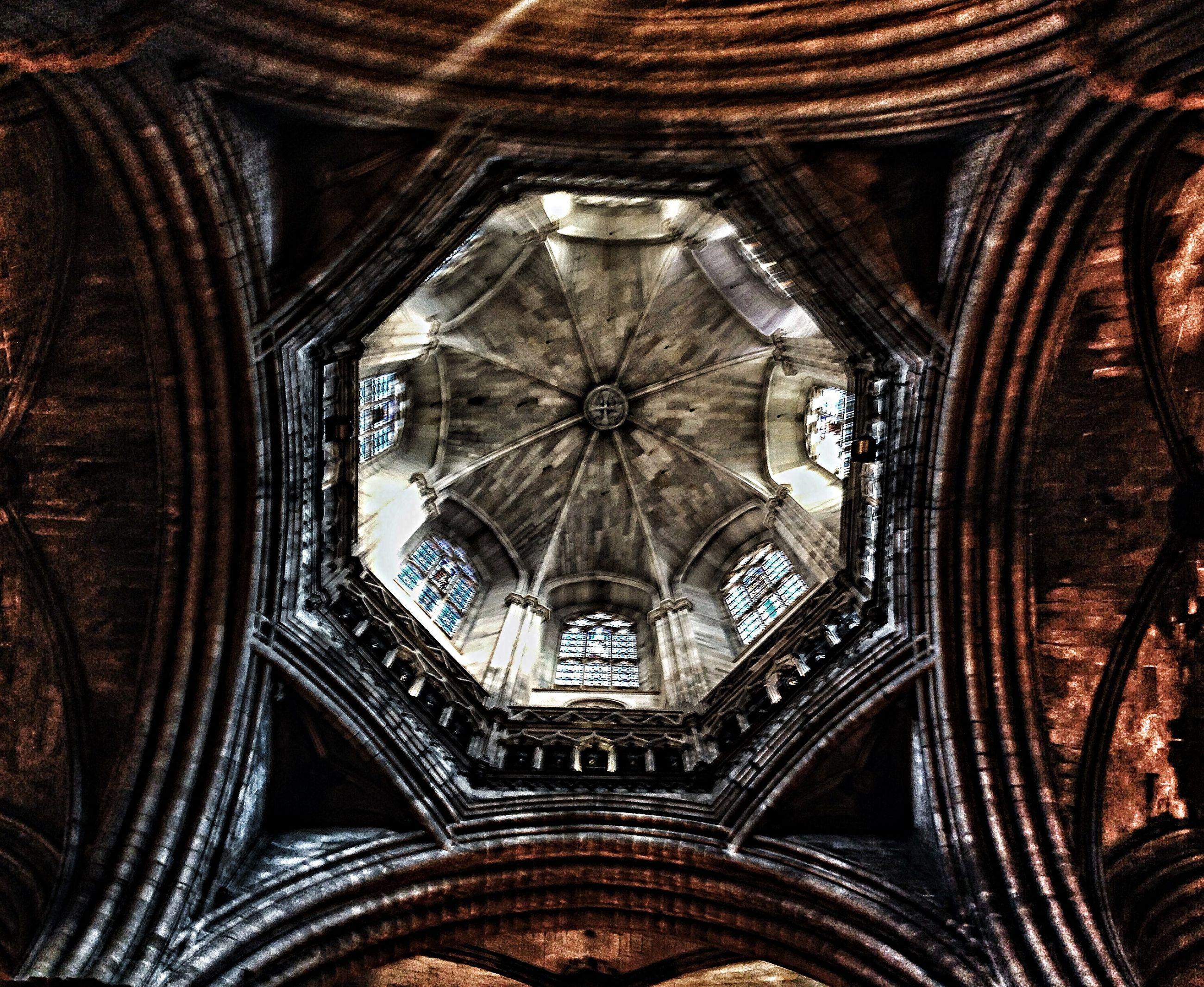 religion, place of worship, indoors, spirituality, church, architecture, arch, cathedral, built structure, ornate, low angle view, ceiling, design, architectural feature, history, famous place, pattern, interior