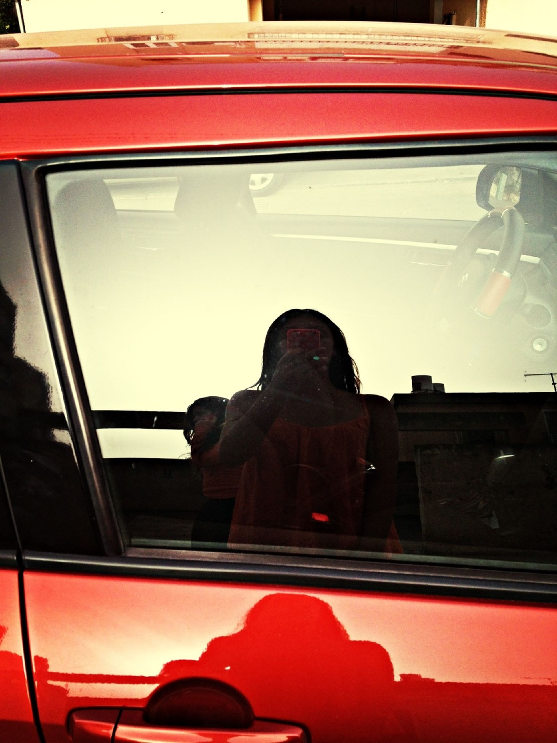 red, mode of transport, transportation, window, car, glass - material, indoors, transparent, land vehicle, reflection, no people, close-up, day, vehicle interior, part of, water, travel, sitting, side view