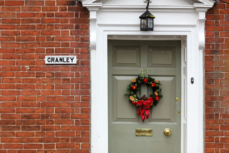 Christmas Architecture Building Exterior Entrance Door Brick Wall No People Outdoors House Christmas Christmas Decoration Alresford, UK Alresford Day Domestic English Village English Village Life