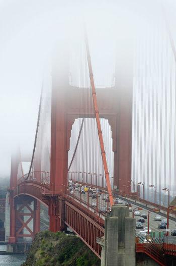 View of suspension bridge in foggy weather