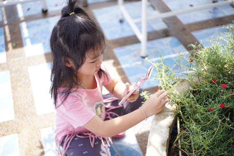 Girl Photographing Flower Through Smart Phone