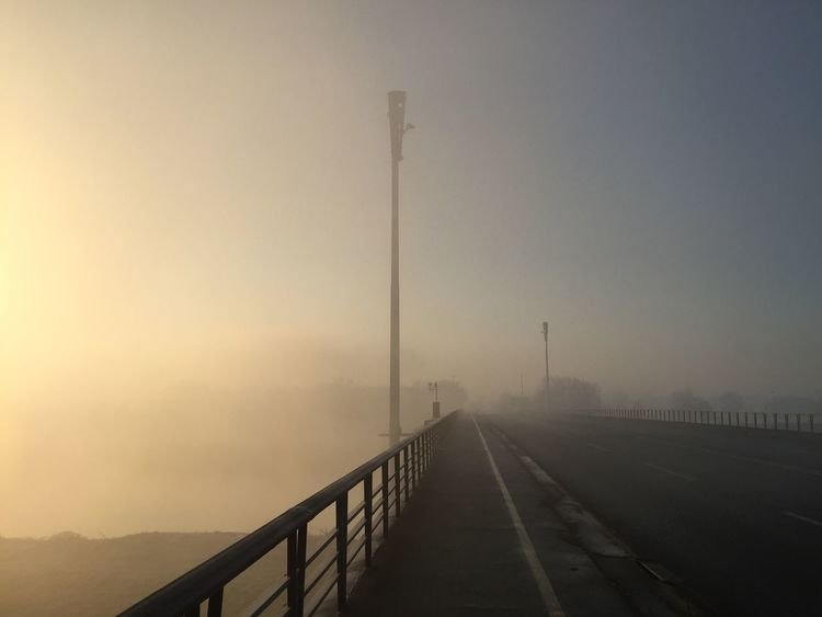 Empty Liberty Bridge at sunrise, surrounded with river mist, Zagreb, Croatia, Dec 11, 2016. Empty Bridge Zagreb Croatia Mist Fog River Mist Sunrise Railing Outdoors Serenity Calamity Calmness Liberty Bridge Architecture River Remembering Adapted To The City The City Light Minimalist Architecture The Architect - 2017 EyeEm Awards