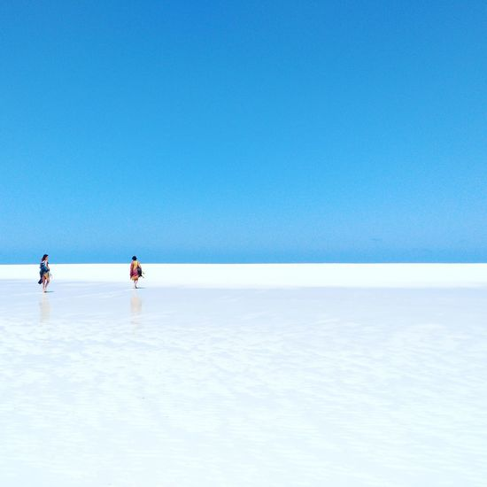 Blue Clear Sky Sea Copy Space Sunny Water Horizon Over Water Sky Sunlight Outdoors Nature Two People Day Leisure Activity Vacations Adults Only Men Beauty In Nature Beach People