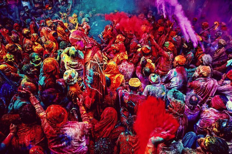 Crowd playing holi