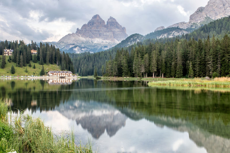 Picturesque lake Misurina Dolomites, Italy EyeEm Nature Lover Beauty In Nature Cloud - Sky Day Growth Idyllic Lake Mountain Mountain Peak Mountain Range Nature No People Outdoors Plant Reflection Reflection Lake Scenics - Nature Sky Tranquil Scene Tranquility Travel Destinations Tree Water Waterfront