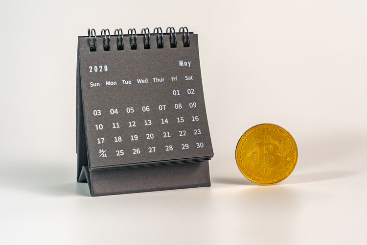 Close-up of coins on table against white background