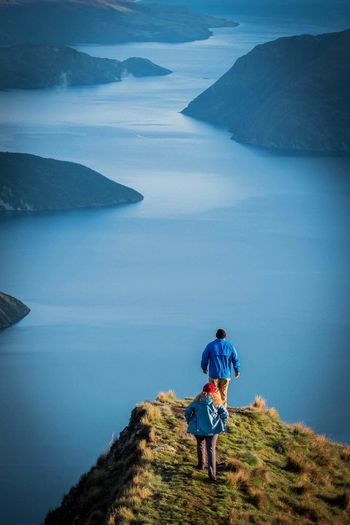 My Year My View Exploration Discovery Rear View The Way Forward Outdoors Nature Travel Destinations Full Length Scenics Cloud - Sky Tranquil Scene Journey People Finding New Frontiers Let's Go. Together. Been There. New Zealand Roys Peak Lost In The Landscape