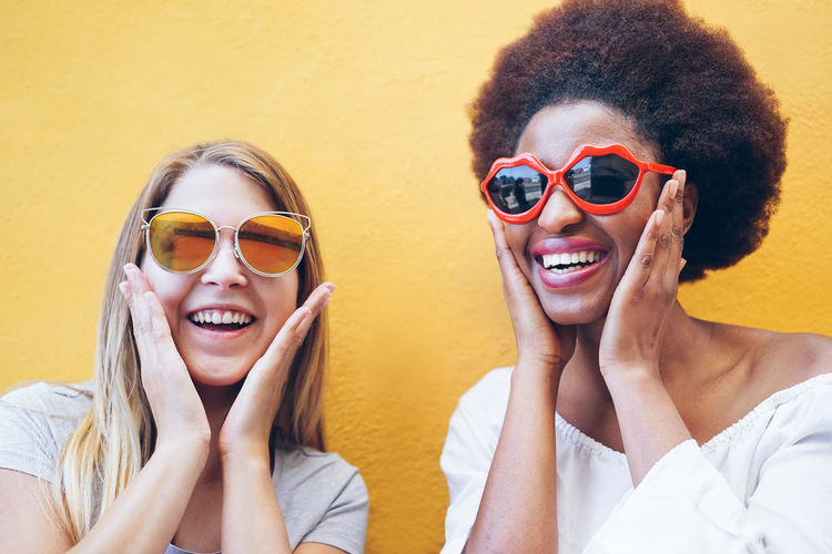 Happy multiracial girls having fun together playing together wearing sunglasses - Young trendy women laughing and smiling - Youth lifestyle and friendship concept - Main focus on afro girl face Sunglasses Smiling Two People Portrait Happiness Fashion Women Togetherness Young Adult Young Women Real People Lifestyles Positive Emotion Beautiful Woman Adult Emotion Millennials Multiracial