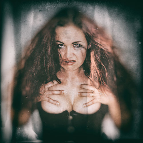 Adult Aggressive Angry Bodice Cleavage Corset Daring Disheveled Emotion Female Front View Indoors  Intimate Irritated Long Hair Looking At Camera Makeup Messy One Person One Young Woman Only Portrait Skin Suggestive Woman Young Adult