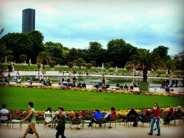 Paris Paris, France  Architecture Building Exterior Built Structure City Cloud - Sky Crowd Day Grass Group Of People Large Group Of People Leisure Activity Luxembourggarden Men Nature Outdoors Park Plant Real People Sky Spectator Tree Women
