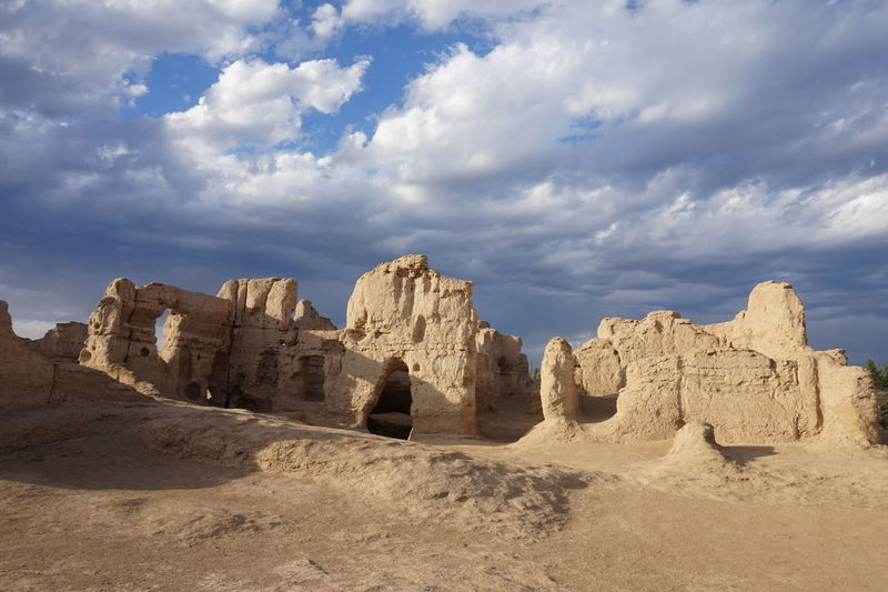 Ruins Of Desert Against Cloudy Sky