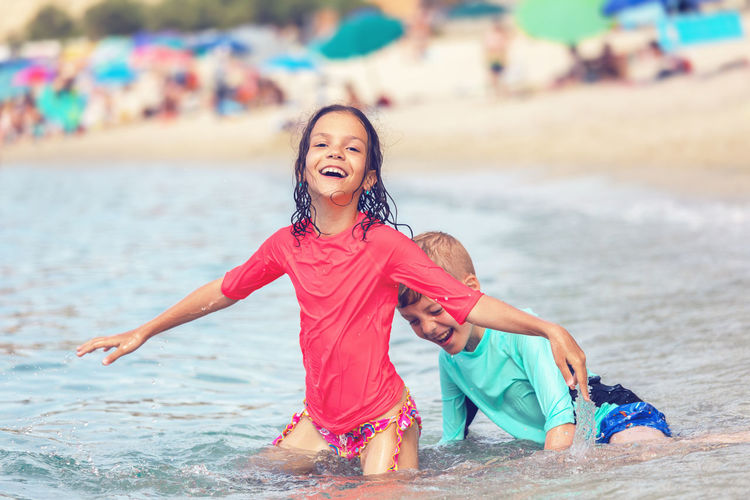 Happy girl on shore at beach