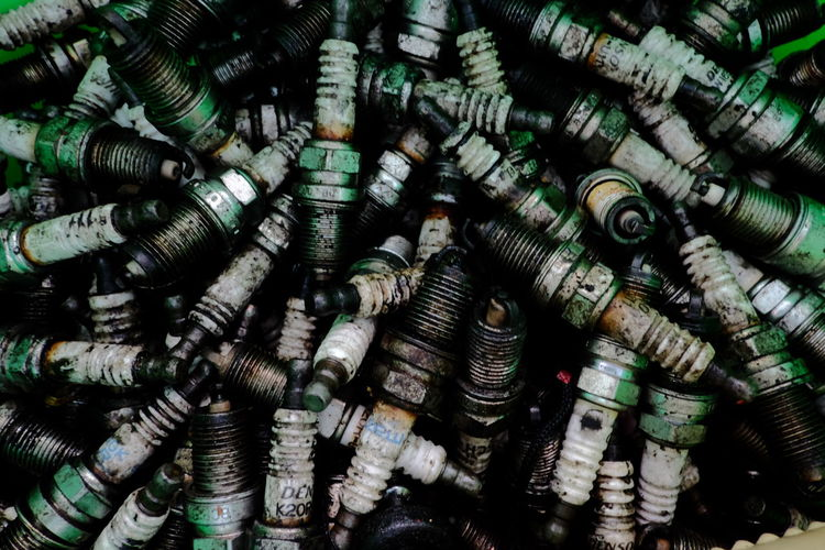 Old sparkplugs Backgrounds No People Indoors  Day Close-up Car Part Spark Plugs Old Car Maintenance Garbage