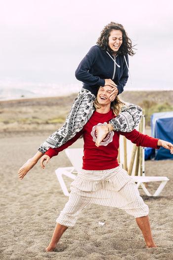 Young couple enjoying at beach