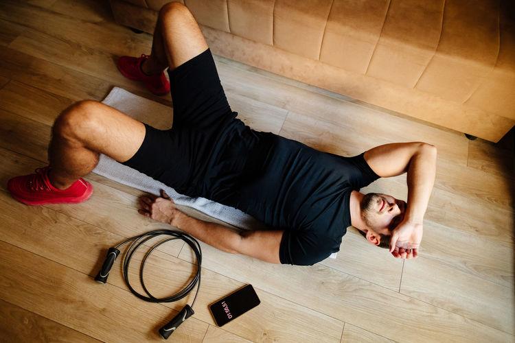 High angle view of man exercising at home