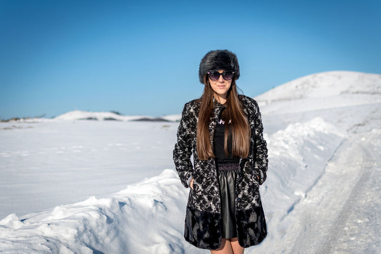 One Person Fashion Sunglasses Leisure Activity Young Adult Glasses Clothing Lifestyles Sky Front View Nature Day Clear Sky Sunlight Adult Real People Snow Standing Outdoors Beautiful Woman Hairstyle