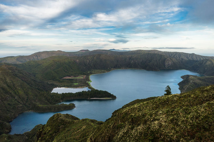 Lagoa do fogo lagoon surrounded by green forest located on sao miguel, azores, portugal.