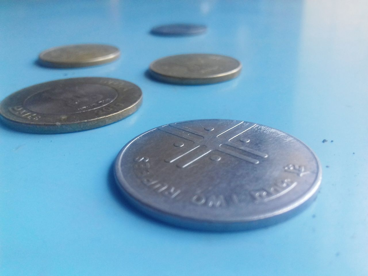 coin, currency, finance, no people, blue, close-up, table, savings, indoors, day
