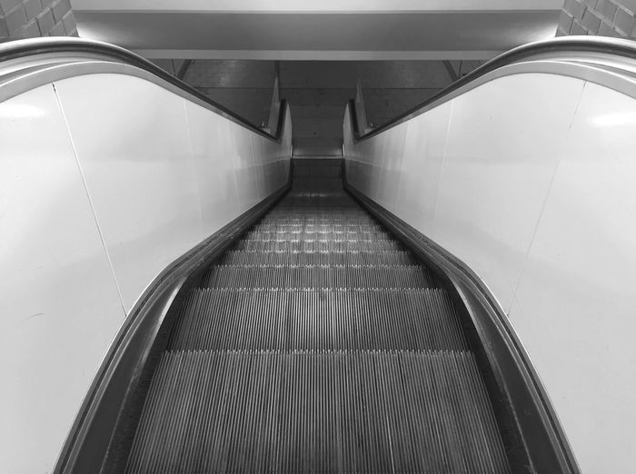 Indoors  Modern No People Illuminated Futuristic Moving Walkway  Technology Architecture Day Escalator Monochrome Black And White Black & White Steps Stairs Monochrome Photography Perspective Symmetry Symmetrical The Way Forward Grey High Angle View Eye4photography  EyeEm Best Shots - Black + White Light And Shadow